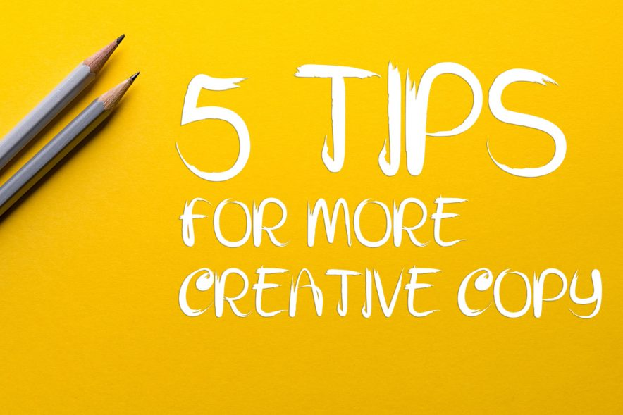 """Two pencils sit beside text which reads, """"5 Tips for More Creative Copy""""."""